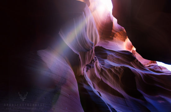 A slot of light coming through a peak in Antelope Canyon